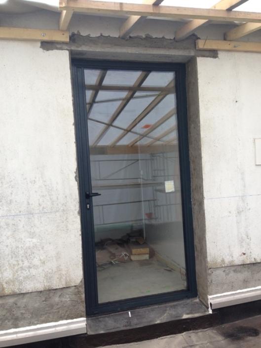 Création d'une porte dans mur de façade